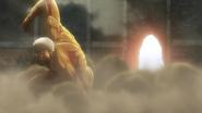 An armored Titan destroys the gate