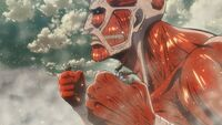 The Colossal Titan grabs Ymir and another soldier