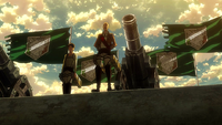 Eren and Pyxis stand in front of soldiers