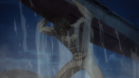 The Attack Titan lifts a Marleyan ship