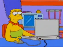 Marge entediada internet laptop