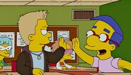 Donny giving milhouse high five