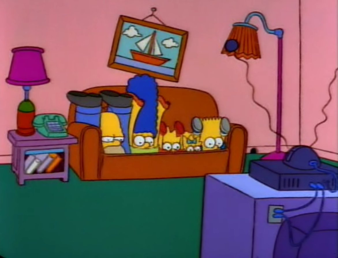 Legs Behind Head couch gag
