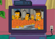 Legs, Louie, and Johnny Tightlips in Orange Jail Suits