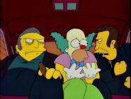 Legs Threatening the Krusty-Dressed Homer