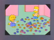 Lisa and Bart young in a photo in And Maggie Makes Three
