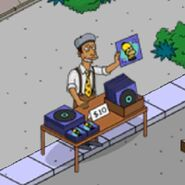 Marbles Le Marquez Selling Albums on the Corner (3)