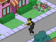 Crook sneaking in the street