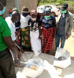 Villagers learn about solar panel cookers