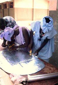 Tilo Tabiro constructing cookers 2008.jpg