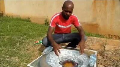 Solar_Tyre_Oven_for_under_$5_How_to_make_a_cheap_solar_cooker_Tire_Oven