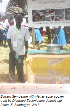 Edward Sembajjwe demonstrates the Heliac solar cooker, 6-22-17.png