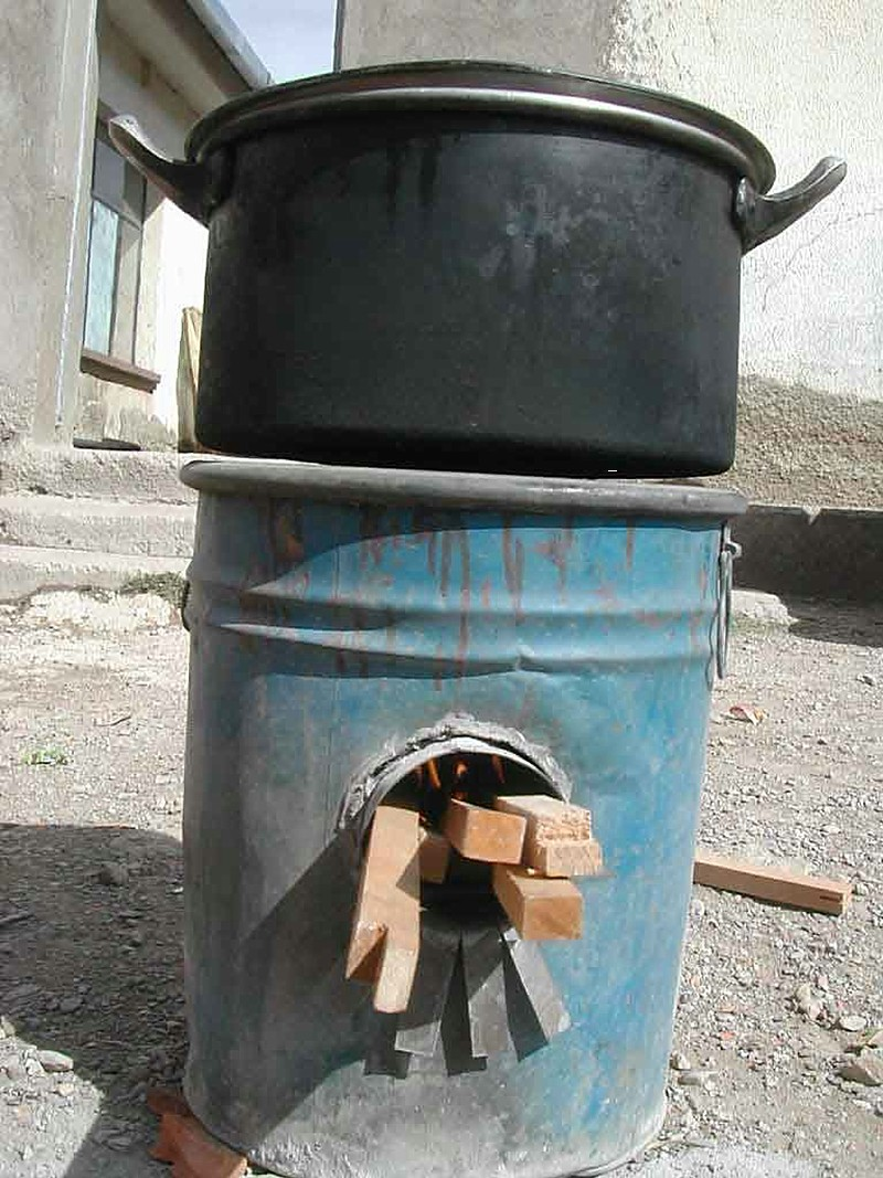 Rocket stove made from barrel in Bolivia.jpg