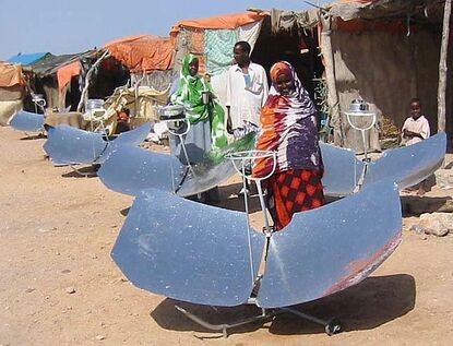 Somalia villagers with cookers.jpg