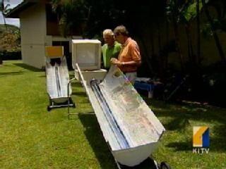 John Grandinetti demonstrates his solar cooker