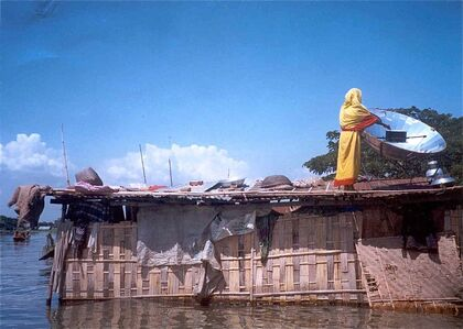 Bangladeshi woman cooking in flood.jpg