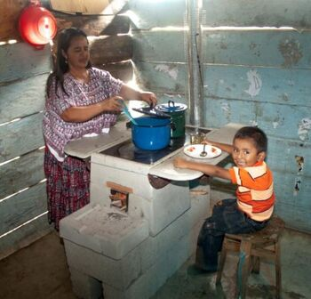 Helps International-stove-mother-and-boy.jpg