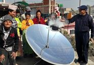 Nepalese group watch solar cooker, SCI, 6-10-21 copy