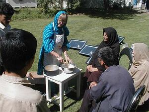 Grace Magney demonstrating solar cooking in Afghanistan.jpg