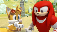 SB S1E13 Tails Knuckles coin