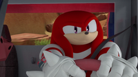Knuckles in his car driving