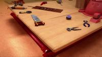 SB S1E23 Tails Workshop table