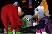 Knuckles y Rouge mirandose a los ojos después de ser salvada por Knuckles..jpg