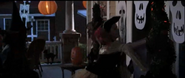 Pirate and witch trick-or-treaters ringing the doorbell