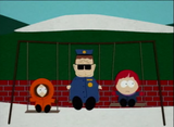 Officer barbrady playing on the swings