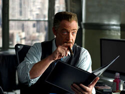 J. Jonah Jameson on his desk.jpg