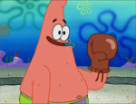 Patrick Wearing a Boxing Glove