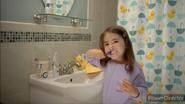 Emma brushes her teeth