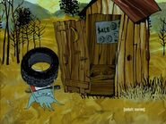 Early holding a tire heading to the outhouse