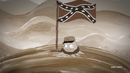 Jefferson Cuyler on top of a hill next to the confedrate flag