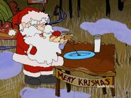 Santa Claus grabbing plastic cookies on a table next to a glass of milk