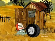 Early and his wheel next to his shed or outhouse