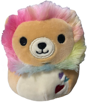 Lion with rainbow mane plush has three hearts stitched into his stomach.