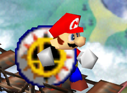 Mario sosteniendo un bumper SSB