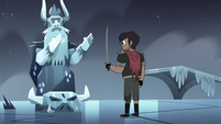 S4E5 Marco standing in front of the statue