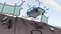 S2E24 Blue car crashes through chain link fence