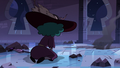 S3E38 Eclipsa kneels in front of Meteora's crater