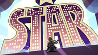S2E40 Ruberiot in front of giant 'STAR' lettering