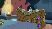 S2E35 Glossaryck reading the book of spells to Ludo