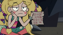 S3E27 Star Butterfly holding out River's scroll