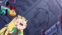 S3E1 Star Butterfly looking at Glossaryck carvings