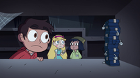 S4E11 Marco looking at stack of sixteen wallets