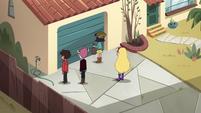 S4E30 Janna and friends in front of garage door