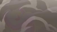 S4E33 Rainbow Kaiju overwhelmed by smoke