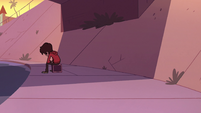 S2E39 Marco Diaz sitting alone under the overpass