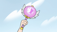 S2E14 Star Butterfly confidently raises her magic wand